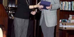 Dr. Morris awards Dr. Postlethwait his plaque